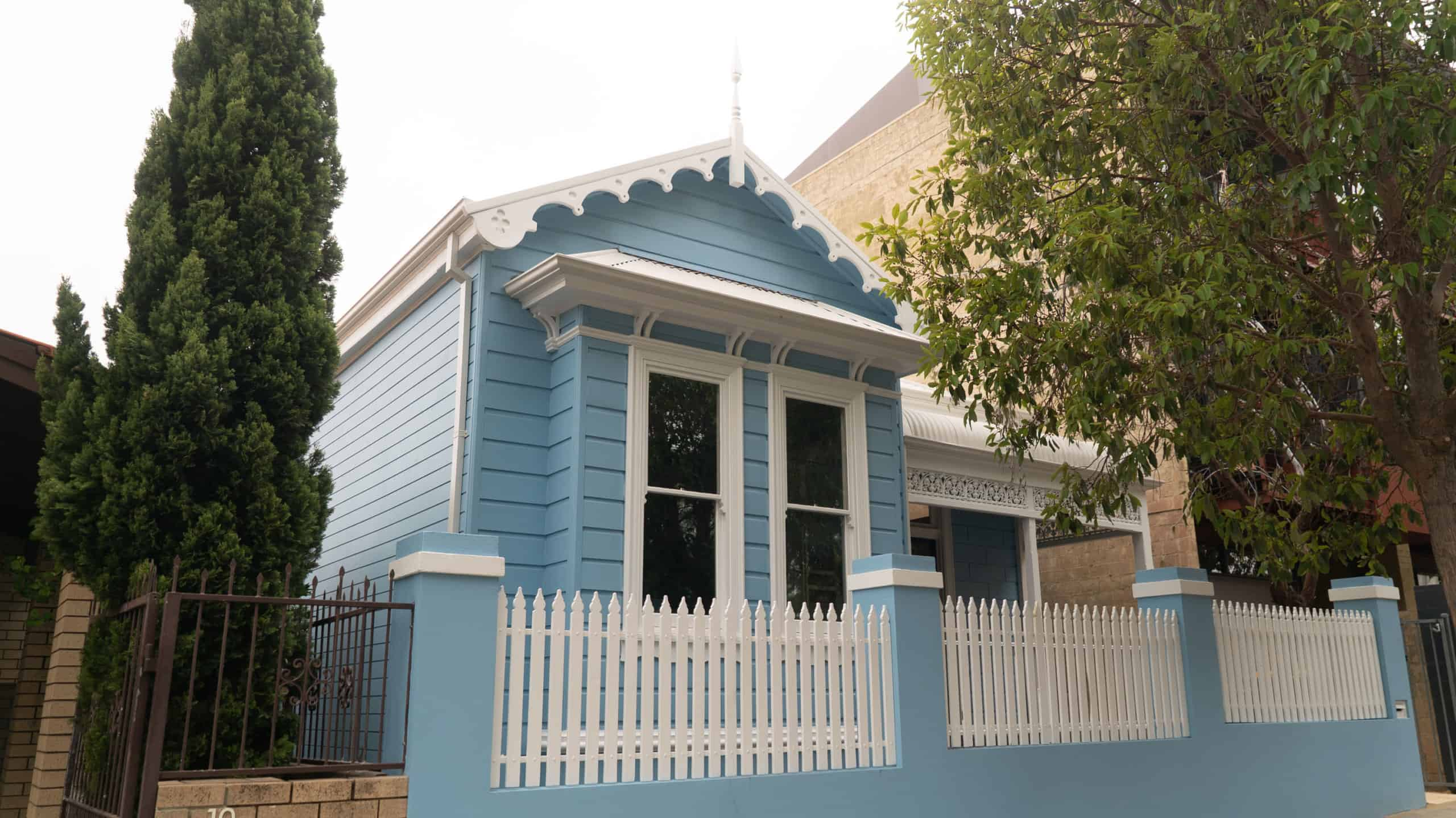 The exterior of a freshly painted, wooden exterior residential property
