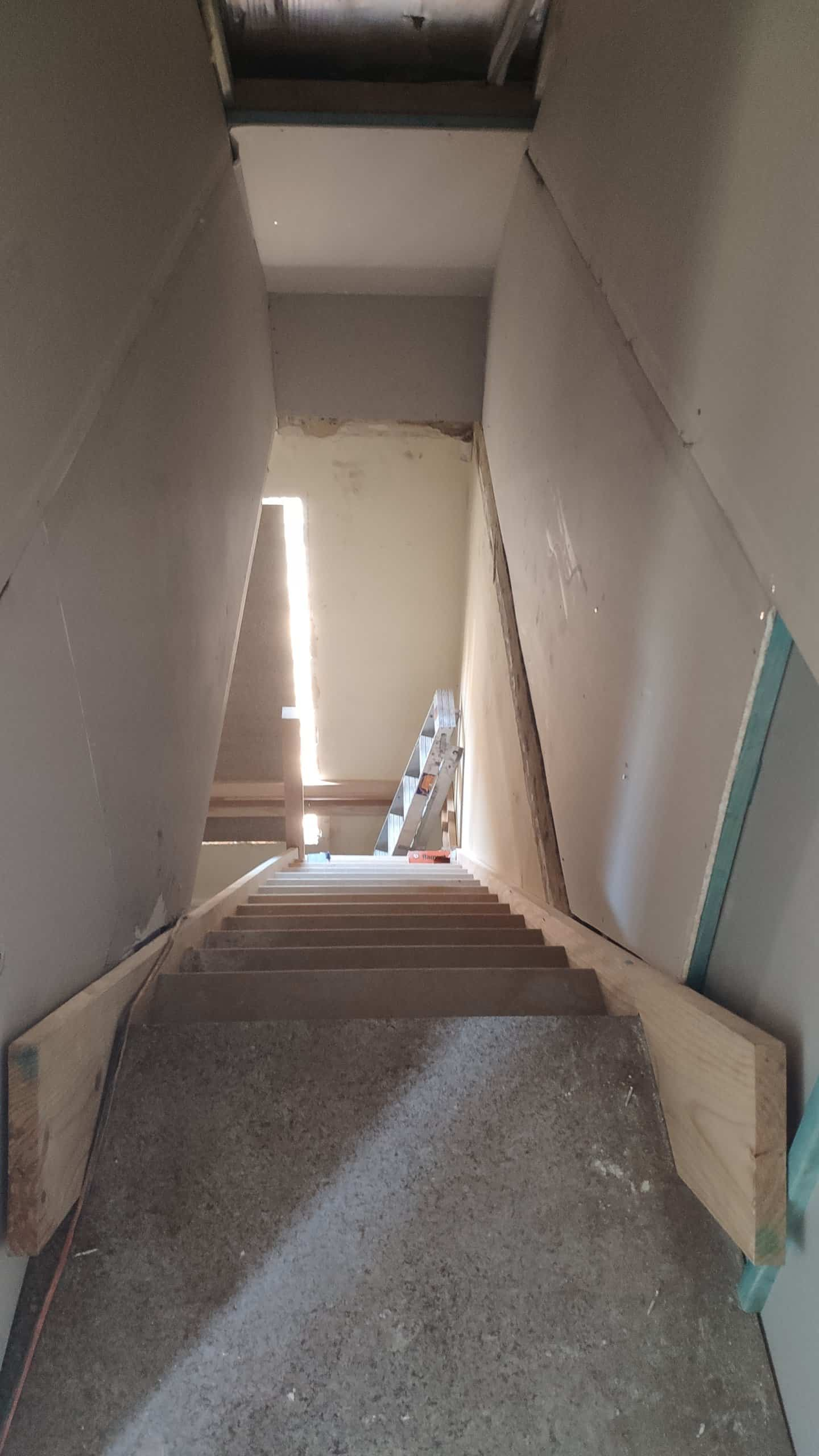 An above view of a partially installed wooden staircase