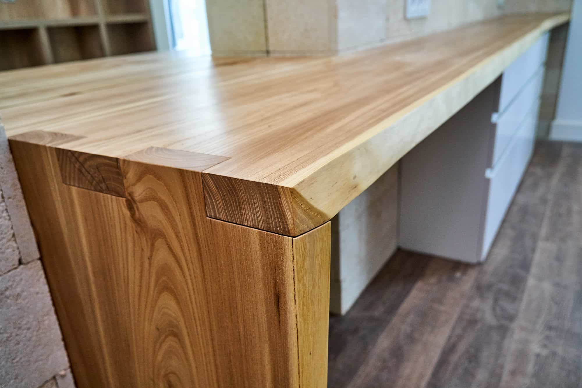 A varnished & finished live edge counter top in a kitchen setting