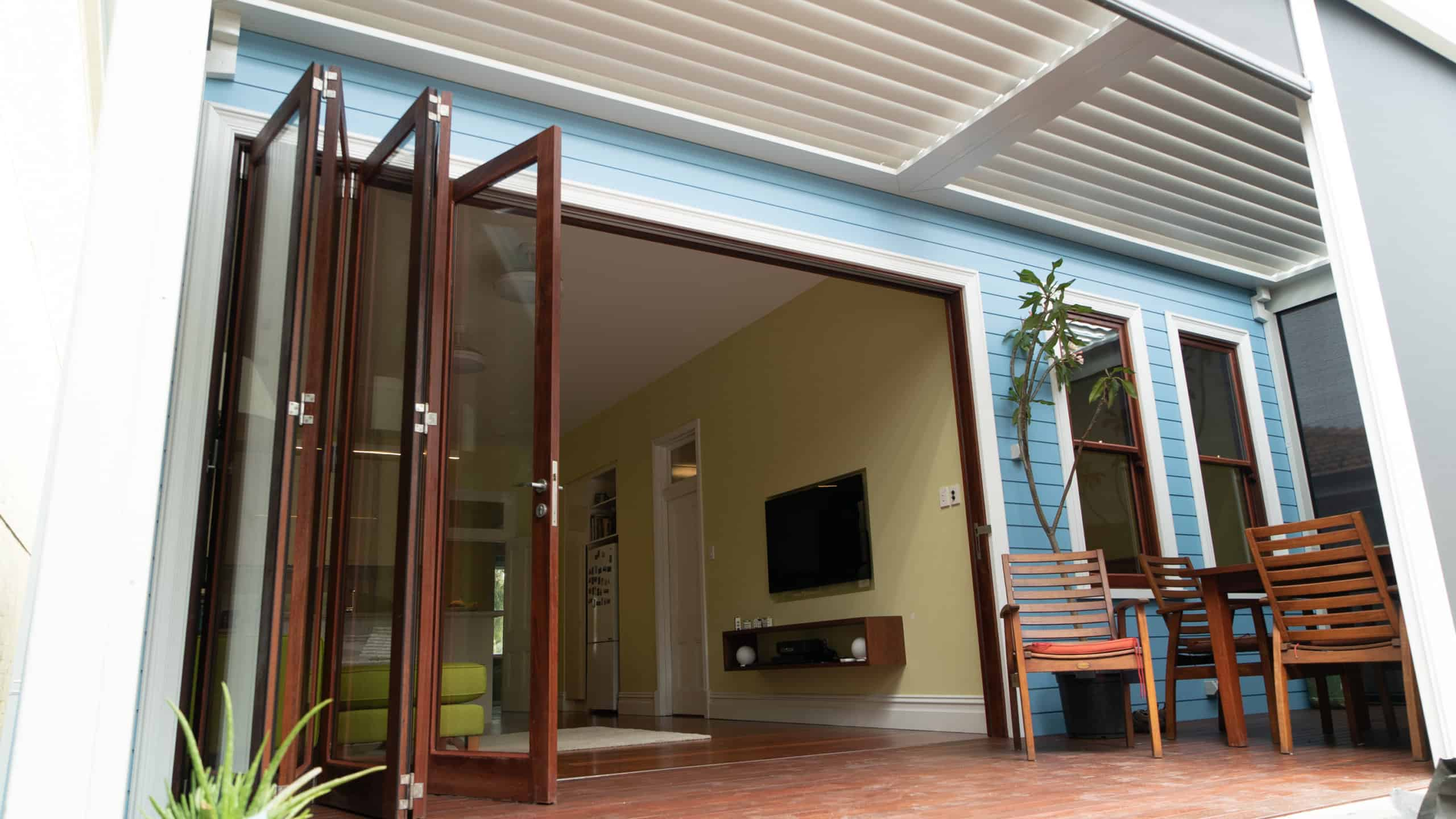 Wooden patio doors opening up onto a patio deck